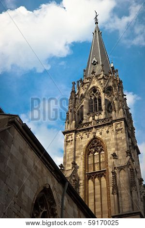 Tower Of Aachen Cathedral Against Blue Sky