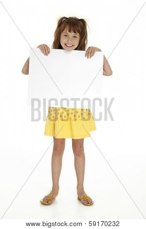 Full length front view of cute little girl holding blank sign on white background.