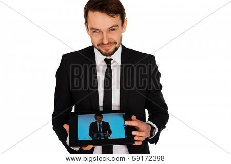 Handsome young businessman with a beard and a friendly smile showing a self-portrait on a tablet computer that he is displaying to the camera