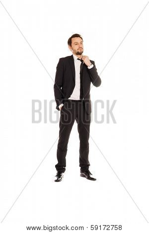 Young businessman under stress with a problem standing adjusting his tie loosening it in an effort to feel more relaxed, full length view isolated on white