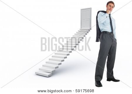 Serious businessman holding his jacket against white steps leading to closed door