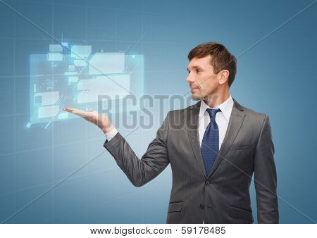 business and office concept - attractive buisnessman or teacher showing virtual screen on the palm