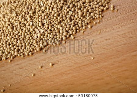 Dry yeast in wooden board table surface top view