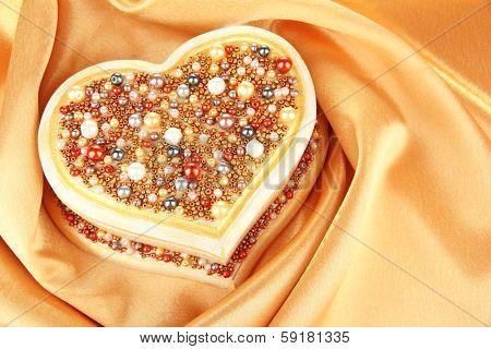 Beautiful hand made casket, on silk background