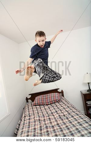 Boy jumping on bed (some motion blur)
