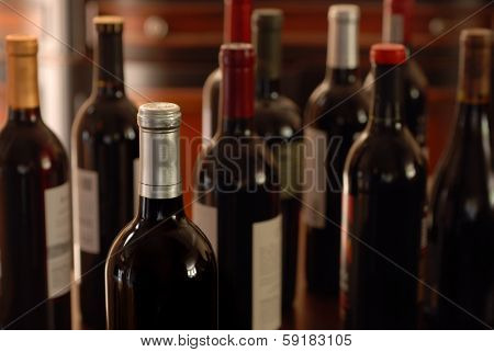 Still life of wine bottles with soft lighting and shallow dof.
