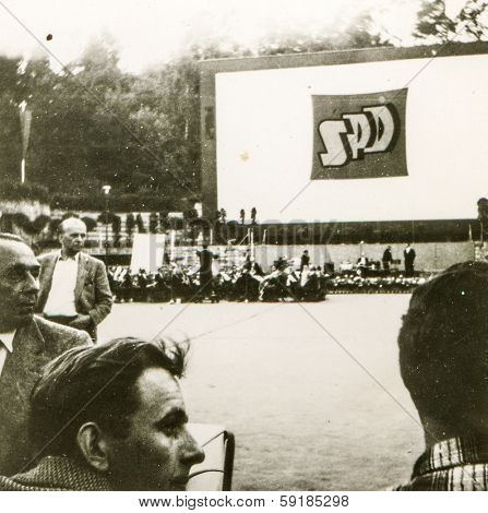GERMANY, CIRCA FIFTIES - Vintage photo of people participating in Social Democratic Party of Germany meeting outdoor