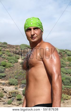 Young Caucasian Muscular Tanned Man