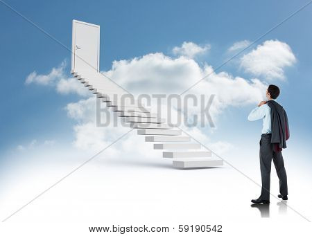 Businessman holding his jacket against steps leading to closed door in the sky