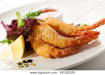 Deep Fried Shrimps with Fresh Salad Leaves and Spicy Sauce