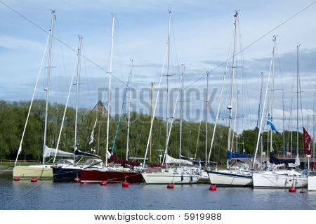 Moored Luxury Sailing Yachts On Summer Day