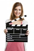 Beautiful blonde woman holding  a clapboard, isolated over white background