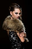 Retro. Attractive woman wearing fur
