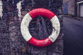 Life Buoy On Old Stone Wall