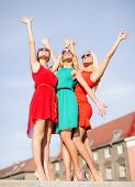holidays and tourism, friends, hen party, blonde girls concept - three beautiful women in the city w