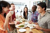 stock photo of hot coffee  - Group Of Friends Meeting For Lunch In Coffee Shop - JPG