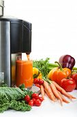 picture of juicer  - A Juicer surrounded by healthy fruits and vegetables on white with shadows - JPG