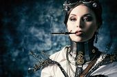 image of post-apocalypse  - Portrait of a beautiful steampunk woman over grunge background - JPG