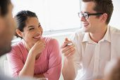 stock photo of meeting  - Happy business people discussing in meeting at office - JPG