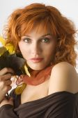image of red hair  - autumn portrait of a young red haired woman with fall leaves near face - JPG