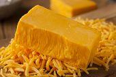 foto of shredded cheese  - Organic Sharp Cheddar Cheese on a Cutting Board  - JPG