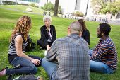 stock photo of senior class  - University class taking place outdoors with small group of students - JPG
