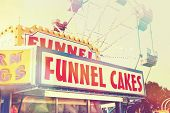 foto of carnival ride  - Funnel cake  stand at a fair - JPG