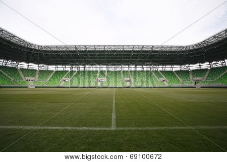 Arena with grandstand. Empty green bleachers at Ferencvaros Budapest stadium.