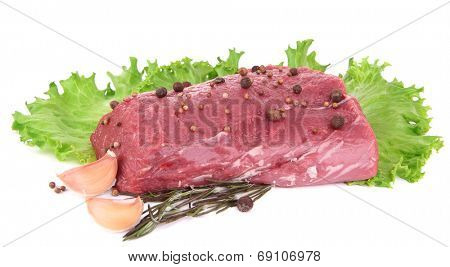 Raw beef meat with lettuce and spices isolated on white
