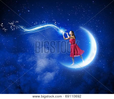 Young woman in red dress standing on moon and playing fife