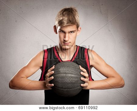 portrait of basketball player on gray background