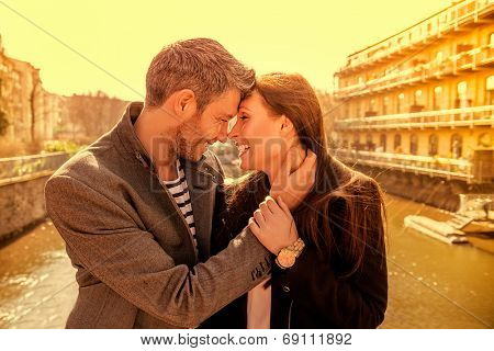 scenic tourists embracing eachother on a bridge
