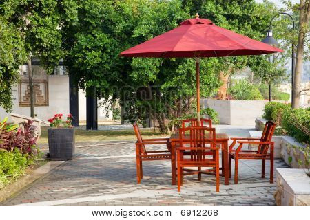 Summer Patio With Tables And Wooden Chairs