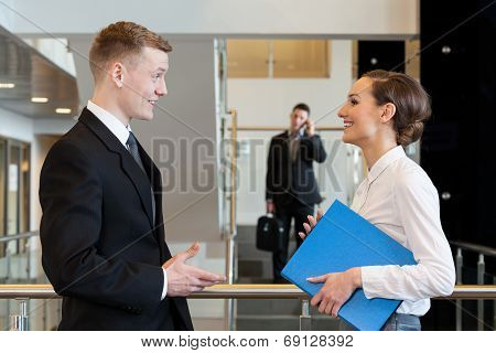 Co-workers Laughing In Business Centre Hall