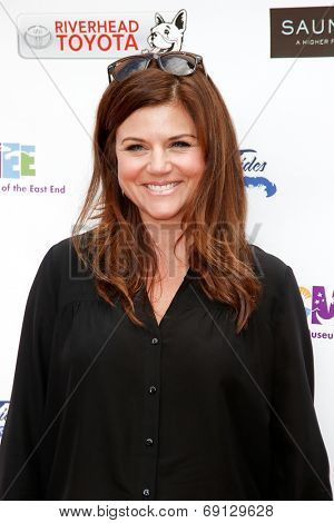 BRIDGEHAMPTON, NY-JUL 19: Actress Tiffani Thiessen attends the 6th Annual Family Fair at the Children's Museum of the East End (CMEE) on July 19, 2014 in Bridgehampton, New York.
