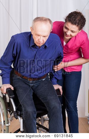 Nurse Helping Disabled Patient