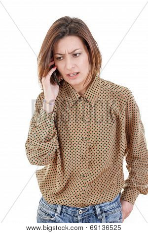 Casual Young Woman Talking On The Phone Hearing Bad News