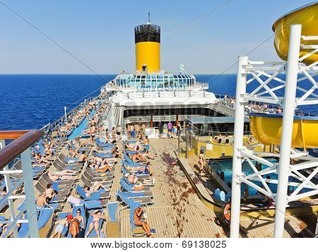 Sunbathing On The Deck Of Cruise Liner