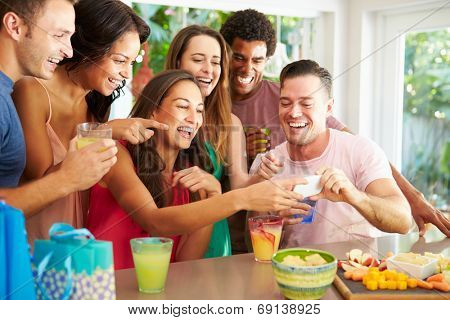 Group Of Friends Taking Selfie Whilst Celebrating Birthday