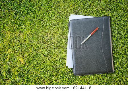 Business Documents On Green Grass