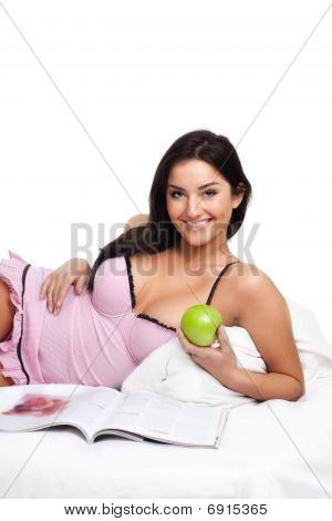 Happy Young Woman In Read Bed