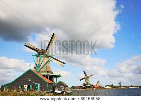 Rural landscape in Holland. Ethnographic rural museum - rural constructions and windmills - a country symbol