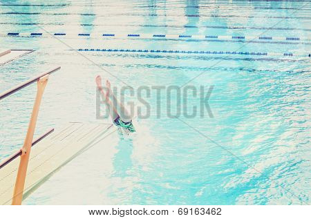 Diver entering the water (focus on the diving board)