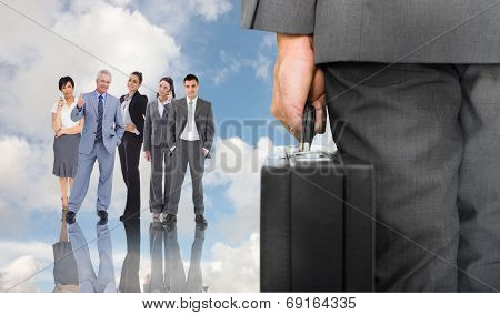 Businessman holding briefcase against blue sky with white clouds and business people