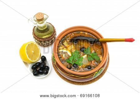 Thistle Soup, Olives, Lemon And Sunflower Oil On A White Background.