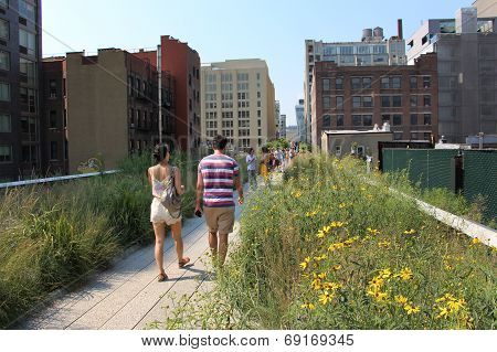People Walk On The Wooden Path Of Highline Park