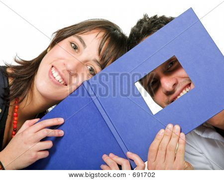 Couple Of Students With Photobook