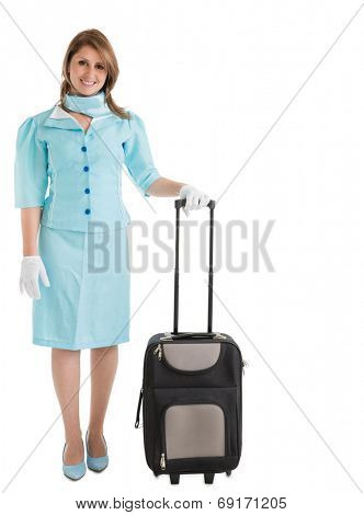 Portrait of stewardess in blue uniform with her bag over white background