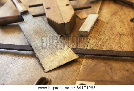 Wood working. Saw, clamps and old wooden boards.
