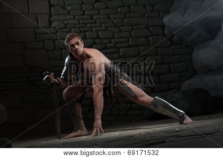 Gladiator with sword kneeling